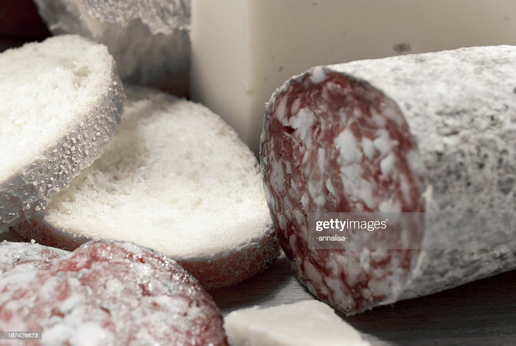 cutting board with bread, cheese and salami : Stock Photo
