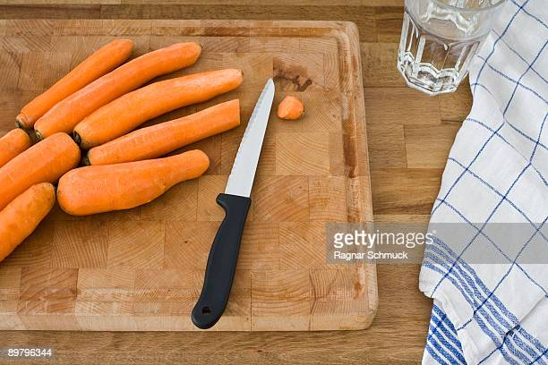 a cutting board with knife and carrots, still life - dish towel stock pictures, royalty-free photos & images