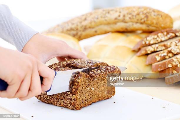Cutting bread.