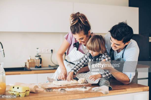 Cutting cookie forms with mom and dad
