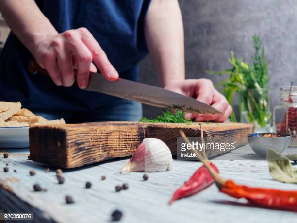 cutting dill - cooking utensil stock photos and pictures