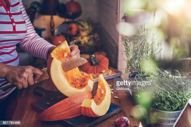 cutting fresh pumpkins for roasting in the oven - food state stock pictures, royalty-free photos & images