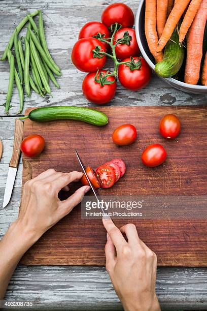 cutting fresh vegetable on vintage garden table - cutting stock pictures, royalty-free photos & images