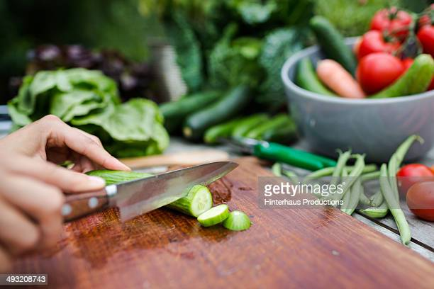 cutting fresh vegetable on vintage garden table - cucumber stock pictures, royalty-free photos & images