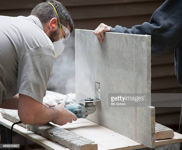 cutting granite - circular saw stock photos and pictures