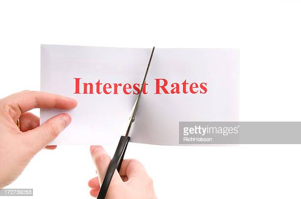 cutting interest rates - interest rate stock pictures, royalty-free photos & images