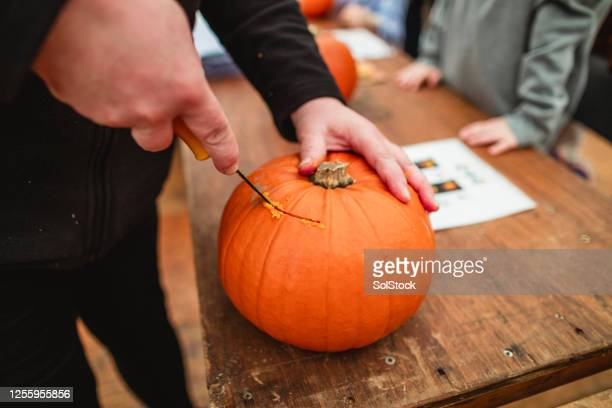 cutting into the pumpkin - carving craft product stock pictures, royalty-free photos & images