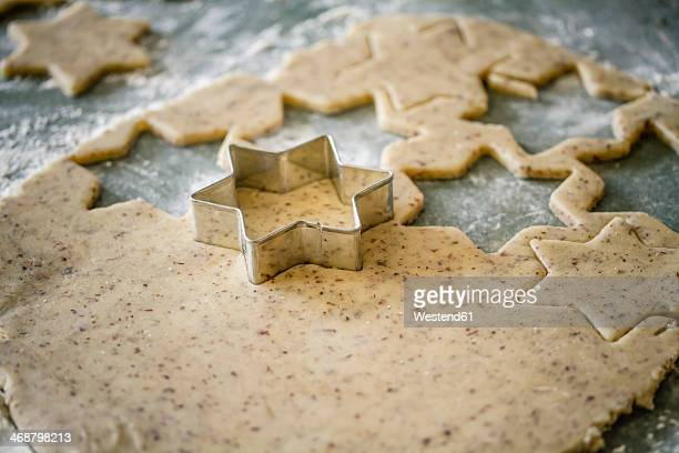 Cutting out star shaped Christmas cookies