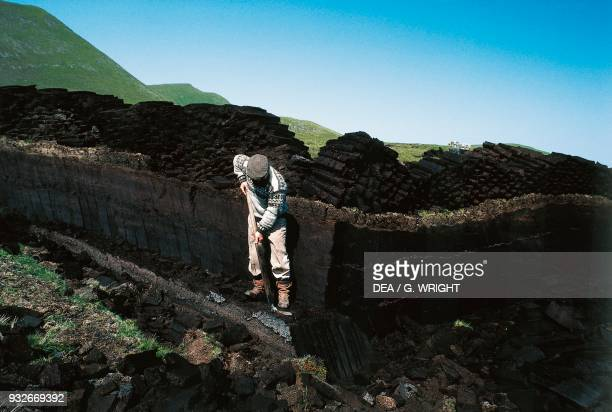 Cutting peat turf island of Foula Shetland Islands Scotland United Kingdom