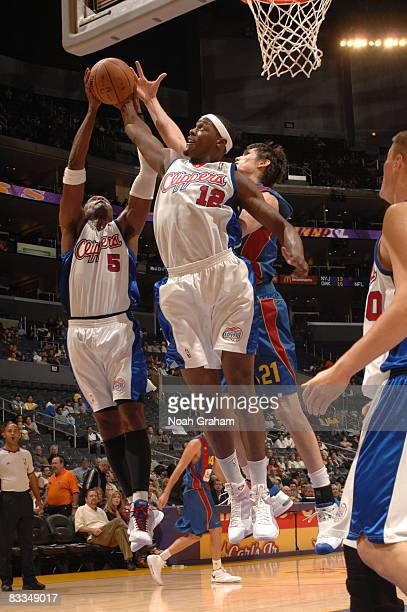 Cuttino Mobley and Al Thornton of the Los Angeles Clippers reach for a rebound during their game against Regal FC Barcelona on October 19 2008 in Los...