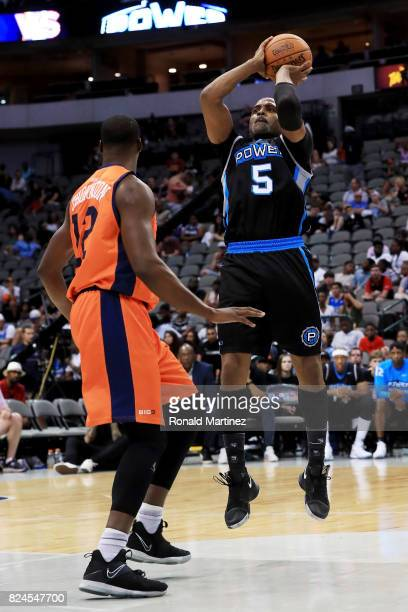 Cuttino Mobley of Power attempts a shot while being guarded by Al Thornton of 3s Company during week six of the BIG3 three on three basketball league...