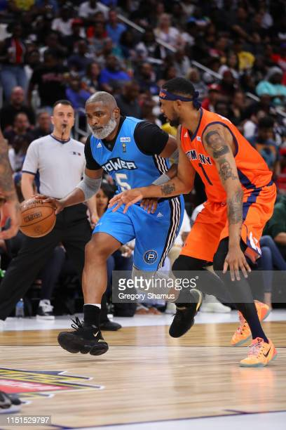 Cuttino Mobley of Power drives to the basket against Dermarr Johnson of 3's Company during week one of the BIG3 three on three basketball league at...