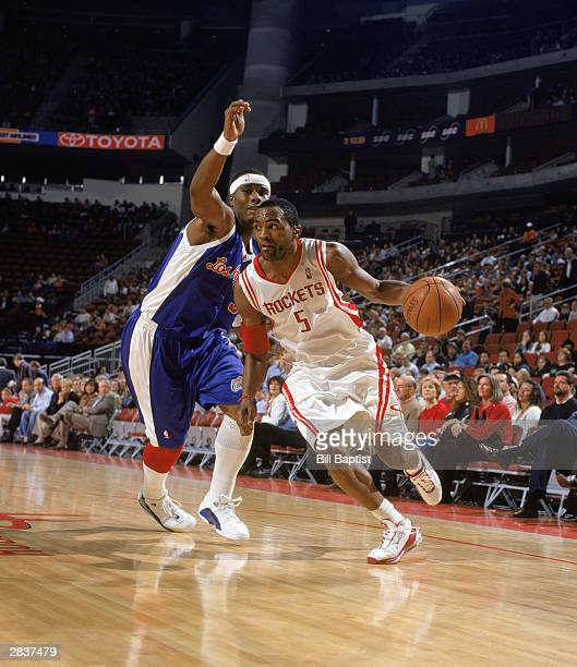 Cuttino Mobley of the Houston Rockets dribble drives past Quentin Richardson of the Los Angeles Clippers during the game on December 19 2003 at...