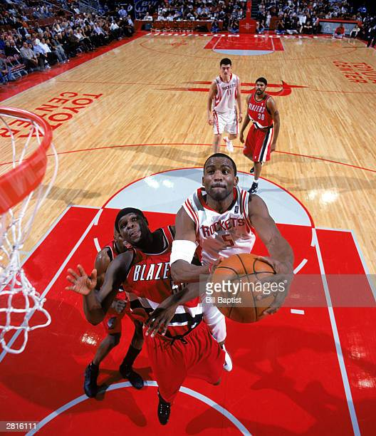 Cuttino Mobley of the Houston Rockets drives to the basket against Zach Randolph of the Portland Trail Blazers during the NBA game at Toyota Center...