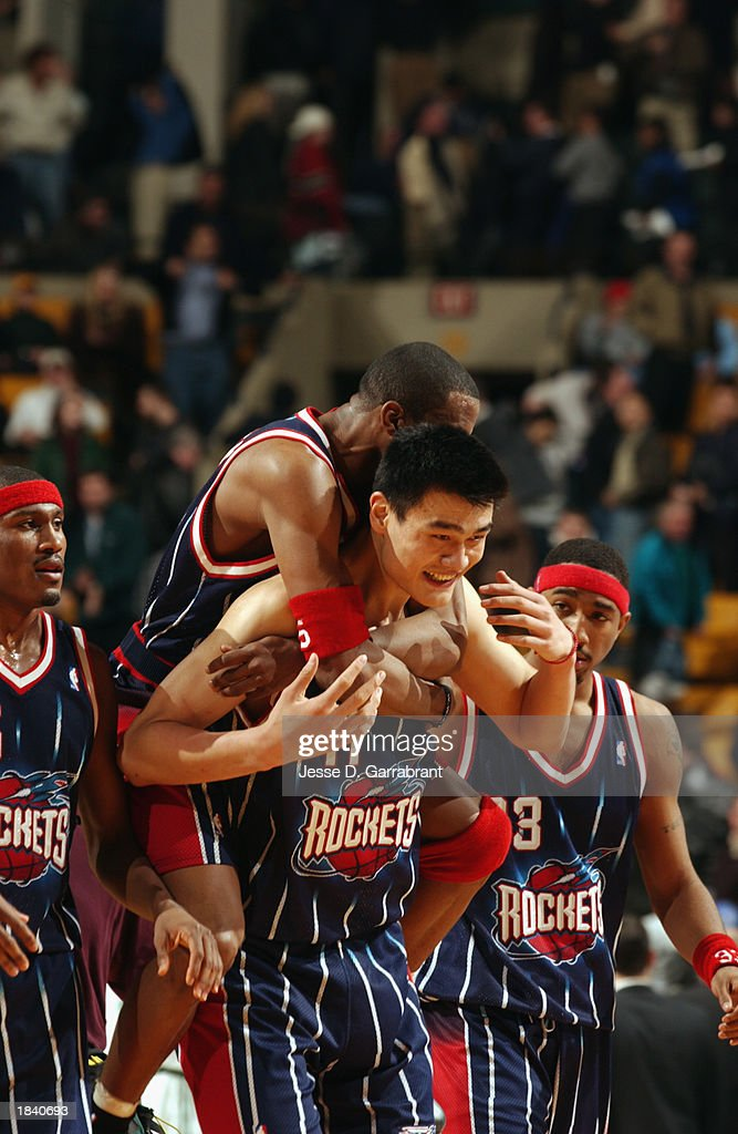 Cuttino Mobley #5 of the Houston Rockets jumps on the back of teammate Yao Ming #11 after defeating the Boston Celtics in overtime during the NBA game at Fleet Center on February 24, 2003 in Boston, Massachusetts. The Rockets won in overtime 101-95.