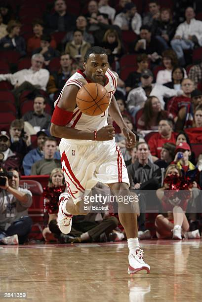 Cuttino Mobley of the Houston Rockets moves the ball up court during the game against the Los Angeles Clippers at the Toyota Center on December 19...