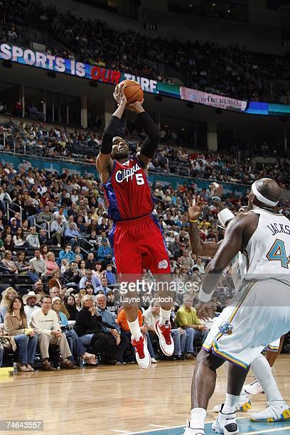 Cuttino Mobley of the Los Angeles Clippers shoots a jumper over Marc Jackson of the New Orleans/Oklahoma City Hornets during a game at the Ford...