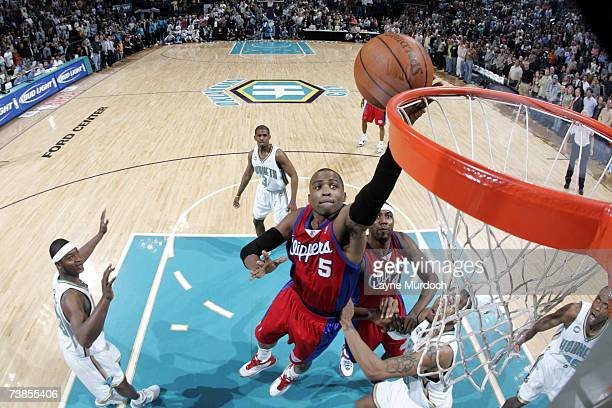 Cuttino Mobley of the Los Angeles Clippers shoots the ball over David West of the New Orleans/Oklahoma City Hornets at the Ford Center April 10 2007...