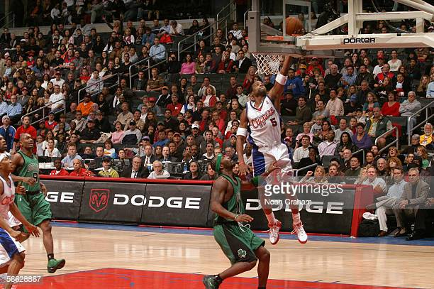 Cuttino Mobley of the Los Angeles Clippers takes the ball to the basket over Ricky Davis of the Boston Celtics during the game on December 31 2005 at...