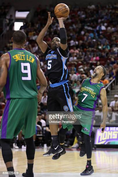 Cuttino Mobley of the Power shoots the ball between Rashard Lewis and Mahmoud AbdulRauf of the 3 Headed Monsters in week nine of the BIG3...