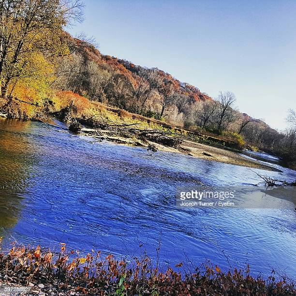 cuyahoga river flowing in forest against sky - cuyahoga river stock photos and pictures