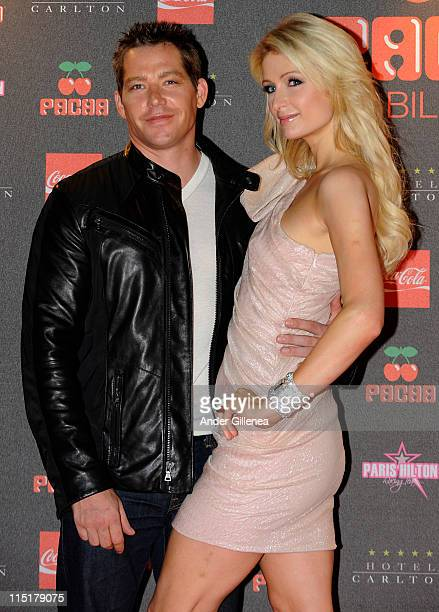 Cy Waits and Paris Hilton pose during a photocall at 'Pacha Lounge Bilbao' Night Club on June 3 2011 in Bilbao Spain