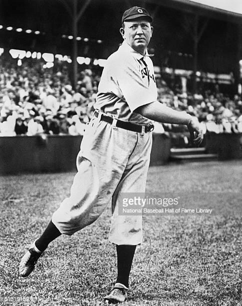 Cy Young pitches for a Cleveland team as he poses for an action portrait In a career that spanned 21 seasons Denton True Cy Young played for the...