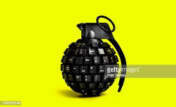 cyber attack grenade on yellow background - terrorism stock pictures, royalty-free photos & images