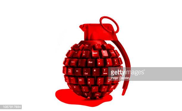 cyber attack red bleeding grenade made from computer keyboard - time bomb stock photos and pictures