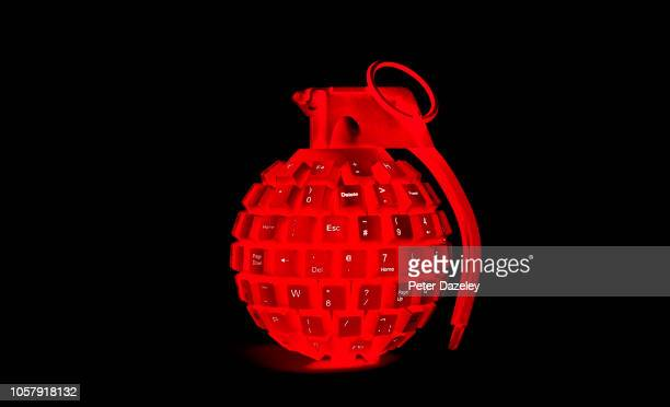 cyber attack red grenade made from computer keyboard - terrorism stock pictures, royalty-free photos & images