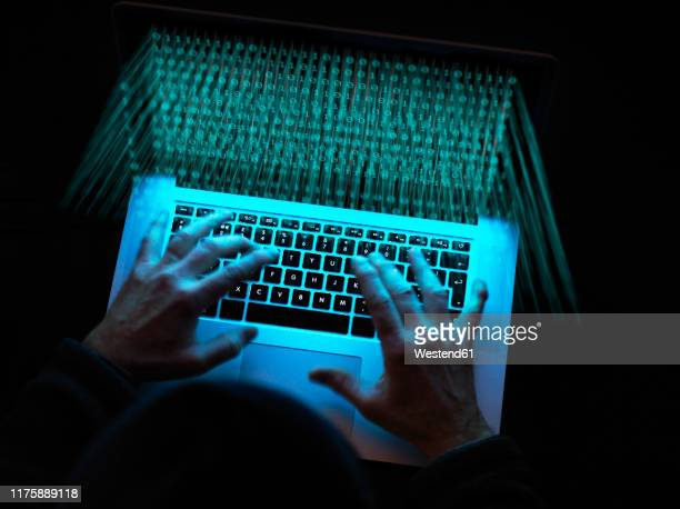cyber crime, a hacker using a virus to attack software - conspiracy stock pictures, royalty-free photos & images