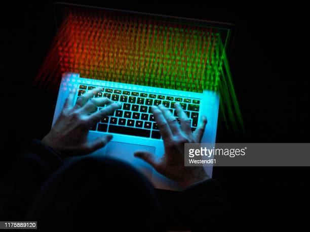 cyber crime, a hacker using a virus to attack software - data privacy stock pictures, royalty-free photos & images
