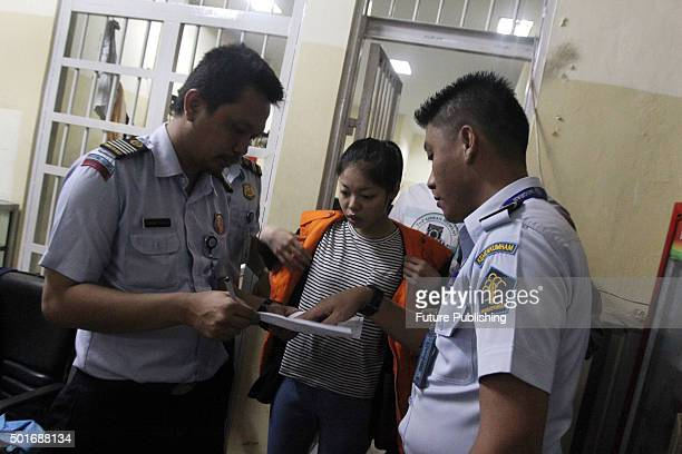 Cyber crime suspects from Taiwan walk out of Jakarta's imigration detention center for their deportation, on December 16, 2015 in Jakarta, Indonesia....
