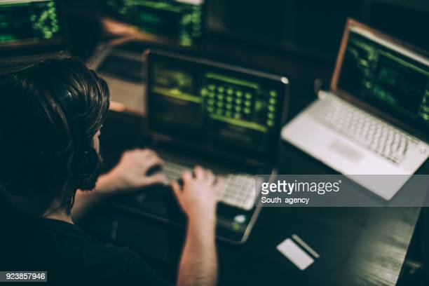 cyber criminal working - threats stock pictures, royalty-free photos & images