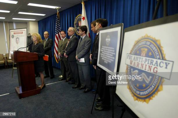 FBI 'Cyber Division' Assistant Director Jana Monroe speaks near a large warning label at a press conference to unveil an FBI antipiracy seal and...