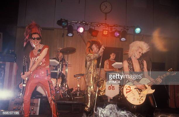 Cyber Punk band Sigue Sigue Sputnik with Martin Degville playing instruments on stage 1980s