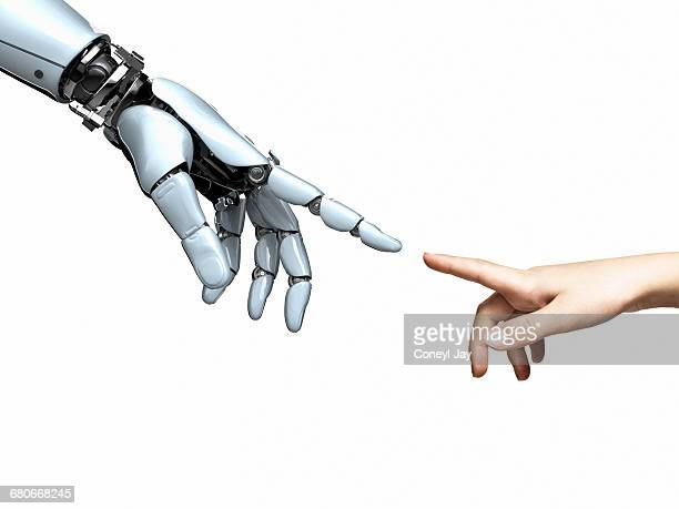 Cybernetic and human hands pointing to each other