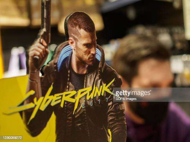 Cyberpunk promo seen at the entrance to the video game store. Cyberpunk 2077 is a 2020 action role-playing video game on sale worldwide. In Russia it...