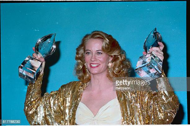 Cybill Shepherd holds up her two awards during the 1987 People's Choice Awards Shepherd was named Favorite Female TV Performer and tied for Favorite...
