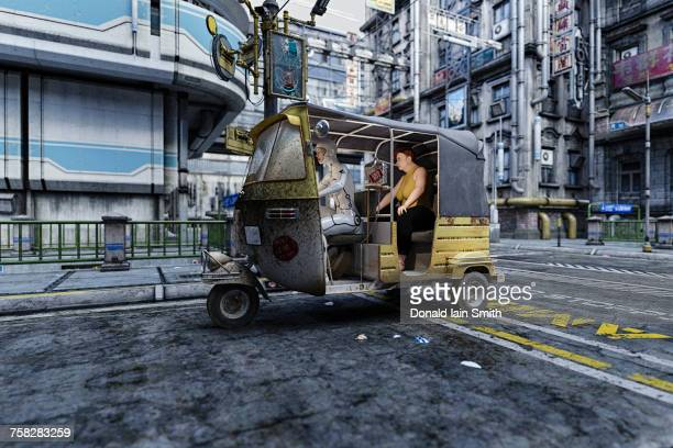 Cyborg driving woman in auto rickshaw