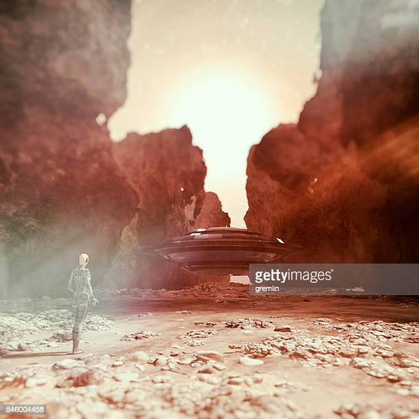 Cyborg walking towards UFO