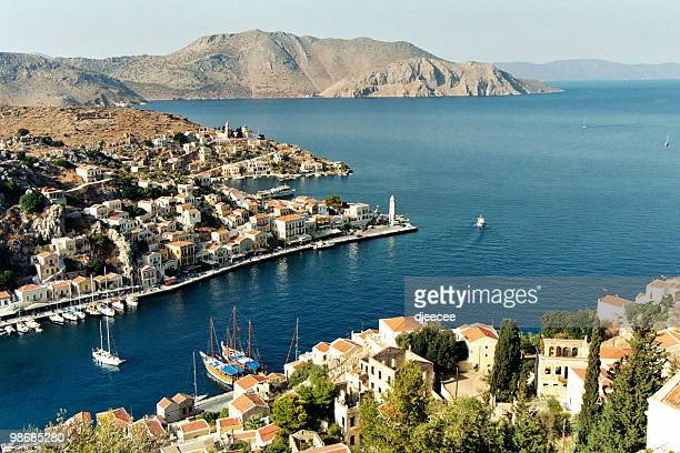 cyclades scenic view 2 - simi (or symi) - symi stock photos and pictures