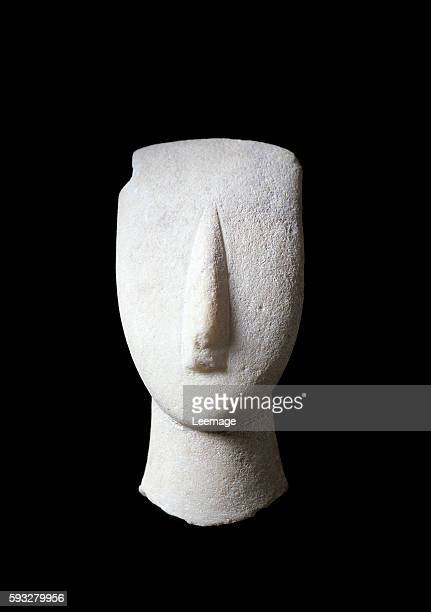 head and neck of a woman white marble figure with ochre incrustations 112 cm Cycladic civilization National Archaeological Museum Athens Greece