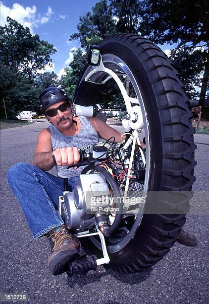 Cycle inventor Kerry McLean poses for the photographer July 27 2000 in Walled Lake Michigan The 'Monocycle' is equipped with a 40horsepower engine...