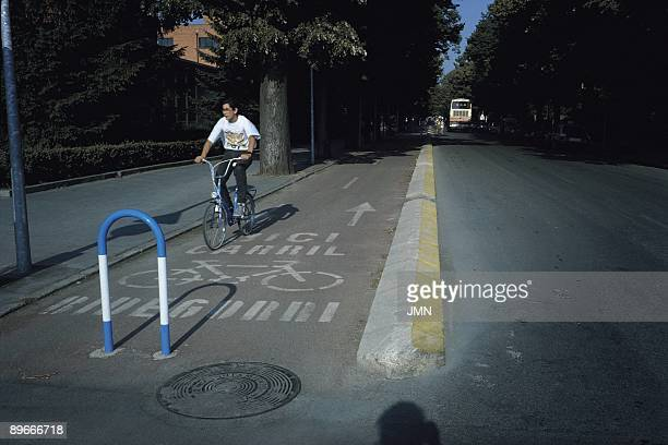 Cycle line A boy drives a bicycle for cycle line in a street of Vitoria Alava province