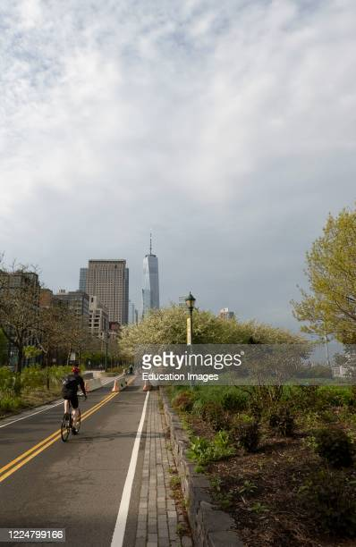 Cycle path alongside the Hudson River The Hudson River Park heading towards Freedom Tower during the Coronavirus lockdown New York USA