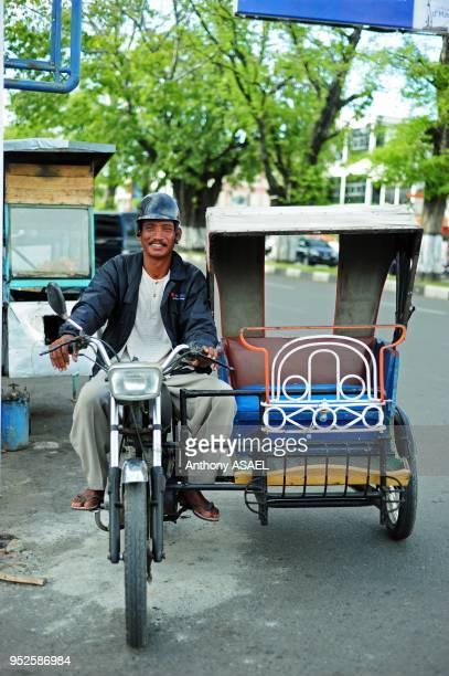 cycle rickshaw driver smiling Banda Aceh Sumatra Indonesia