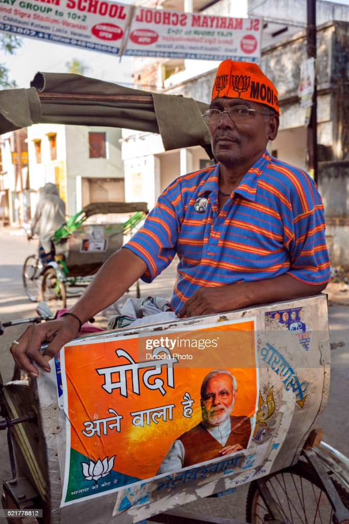 Cycle rickshaw Driver Wearing Modi Cap, Varanasi, uttar pradesh, India : Stock Photo