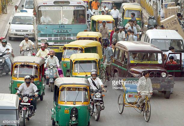 Cycle Rickshaws on a crowded street in India on March 22 2004 in New Delhi India The metropolitan area has population of around 23 million and city...