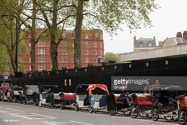 Cycle rickshaws wait to pick up fares from visitors leaving the RHS Chelsea Flower Show on May 21 2013 in London England The Chelsea Flower Show run...